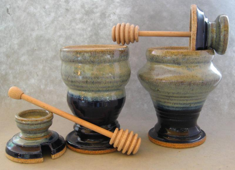 clay honey pots with wooden stick