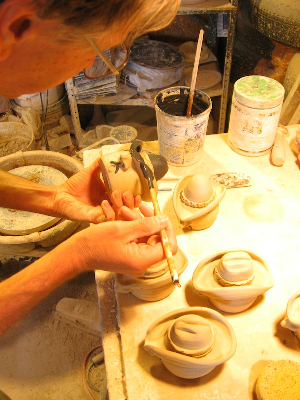 West Magoon making pottery cowboy salt shakers